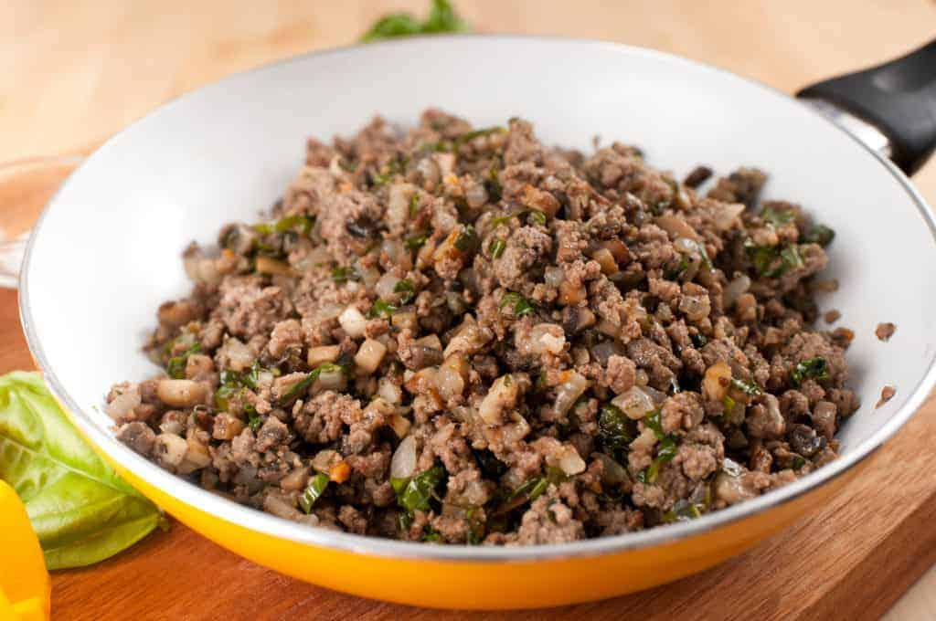 frying pan with cooked ground beef