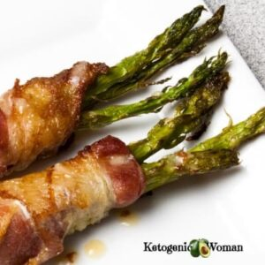 Bacon wrapped asparagus on white plate