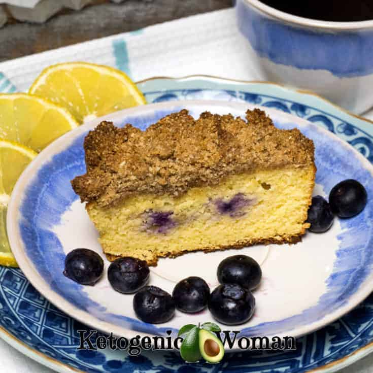 Coffee with Low Carb Lemon Blueberry Coffeecake with a crumb topping on blue and white plate set