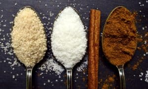 sugar and sweeteners in spoons