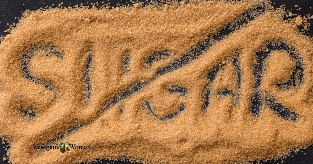 brown sugar spread out on black background
