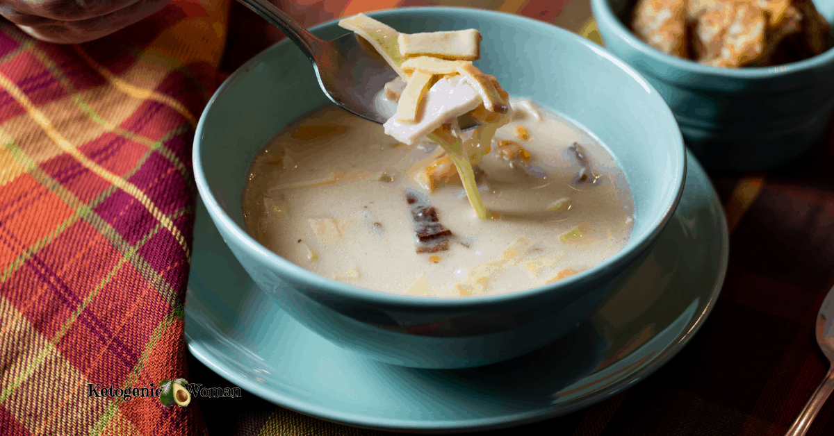 ham and cheese soup in a bowl on plaid mat