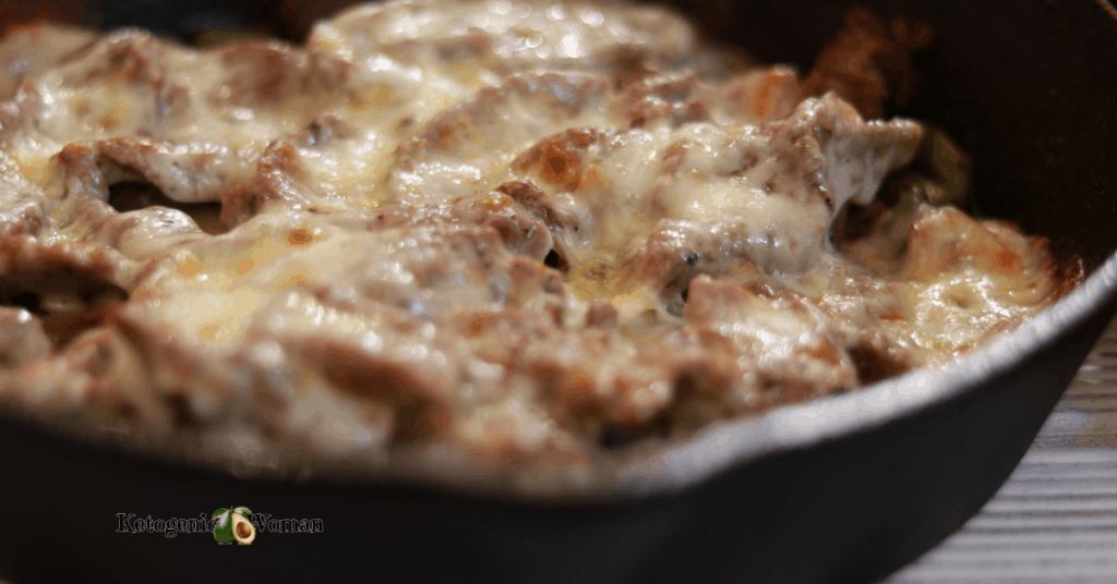 closeup shot of cheesesteak in pan