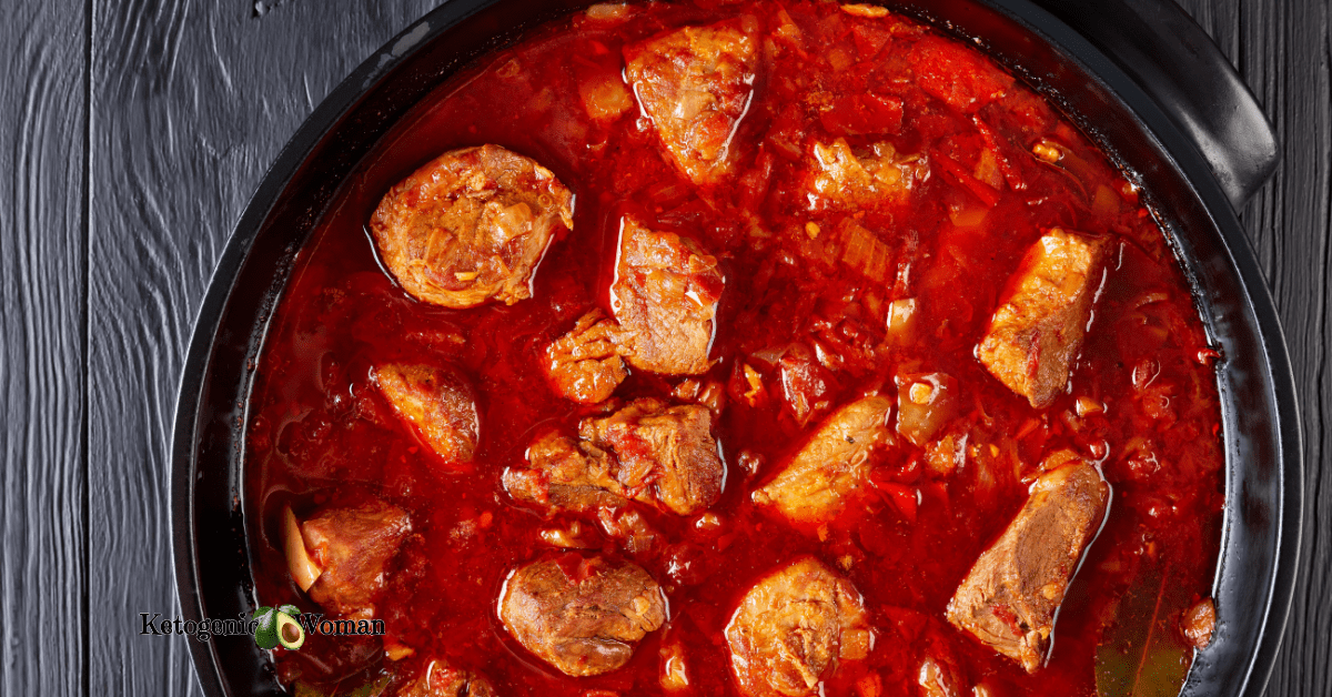bowl of hearty stew against dark background